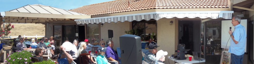 man presenting on a patio
